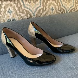 Chloe black patent and snakeskin heels.